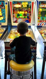 Silverball Arcade Boy Playing Pinball